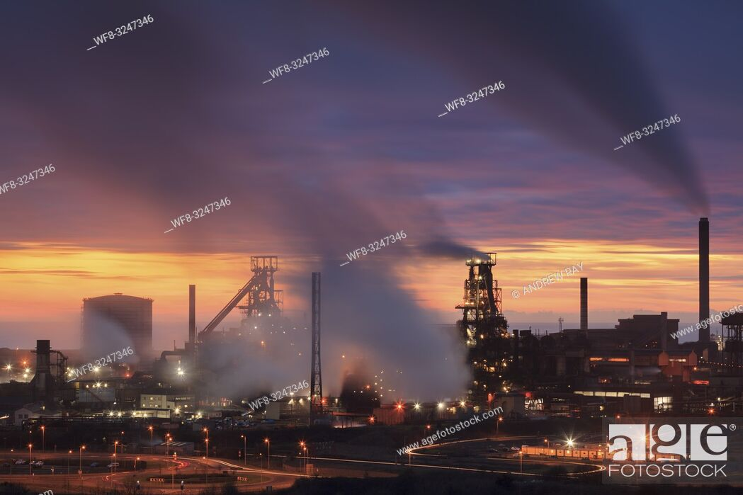Stock Photo: The Tata Steelworks at Port Talbot, in South Wales, captured at sunset from an inland section of the Wales Coast Path on an evening in mid February.