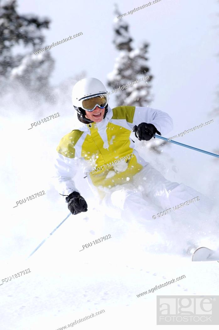 Stock Photo: Woman skiing, Snowbird, Utah.