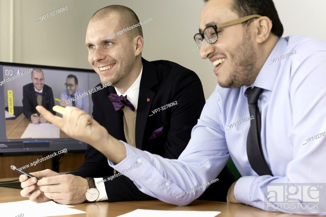 Imagen: happy business men at conference, lawyers consulting at online live stream, in Cottbus, Brandenburg, Germany.