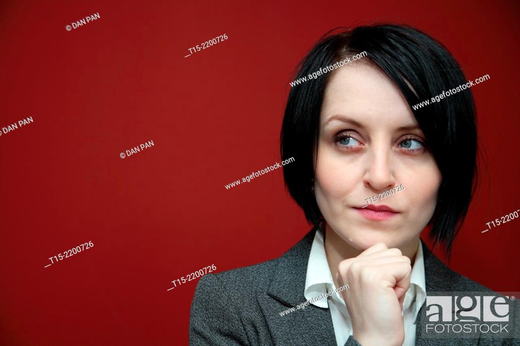 Stock Photo: A black haired young woman contemplating.