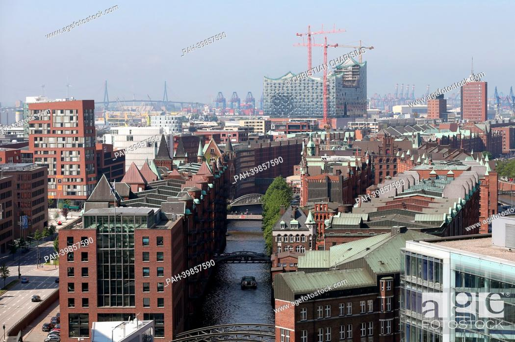 Stock Photo: The historic Speicherstadt(C) in HafenCity (L) with the Elbe Philharmonic Hall (back) is pictured from a tethered hot-air balloon in Hamburg, Germany.