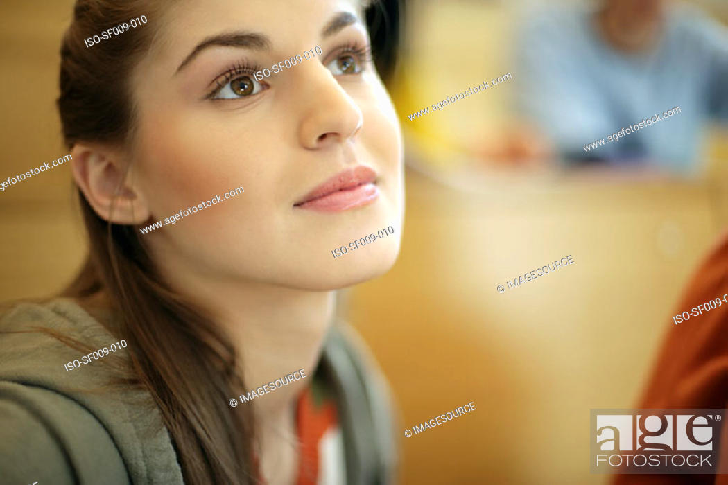 Stock Photo: Young woman daydreaming.