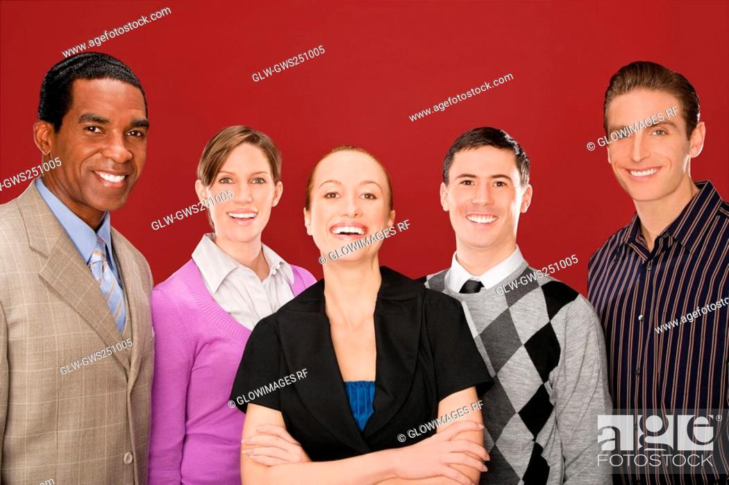 Stock Photo: Portrait of four business executives smiling.