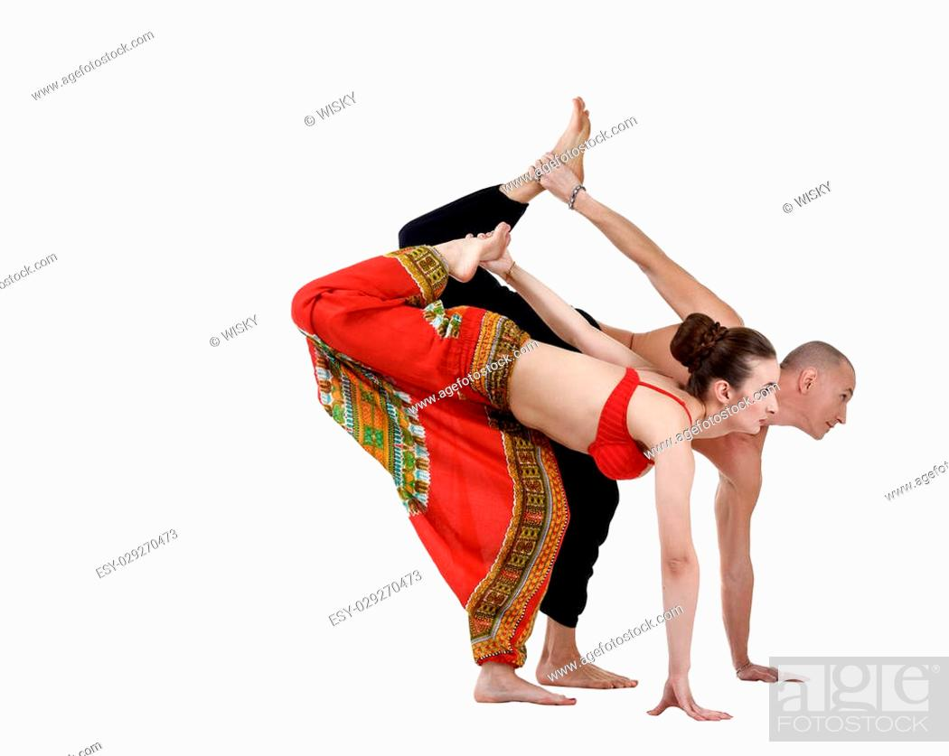 Stock Photo: Paired yoga training of man and woman, isolated on white.