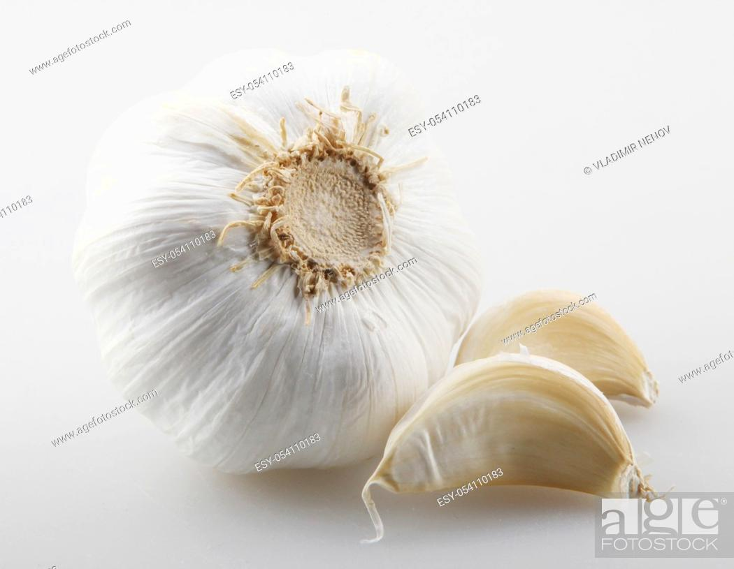 Stock Photo: Close-Up Of Garlic Clove Against White Background.