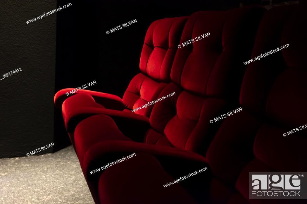 Stock Photo: Red Cinema Chair in Switzerland.