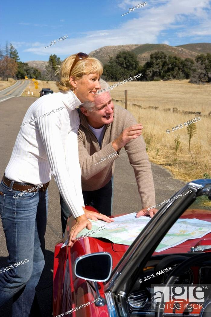 Stock Photo: Couple looking at map on road trip.