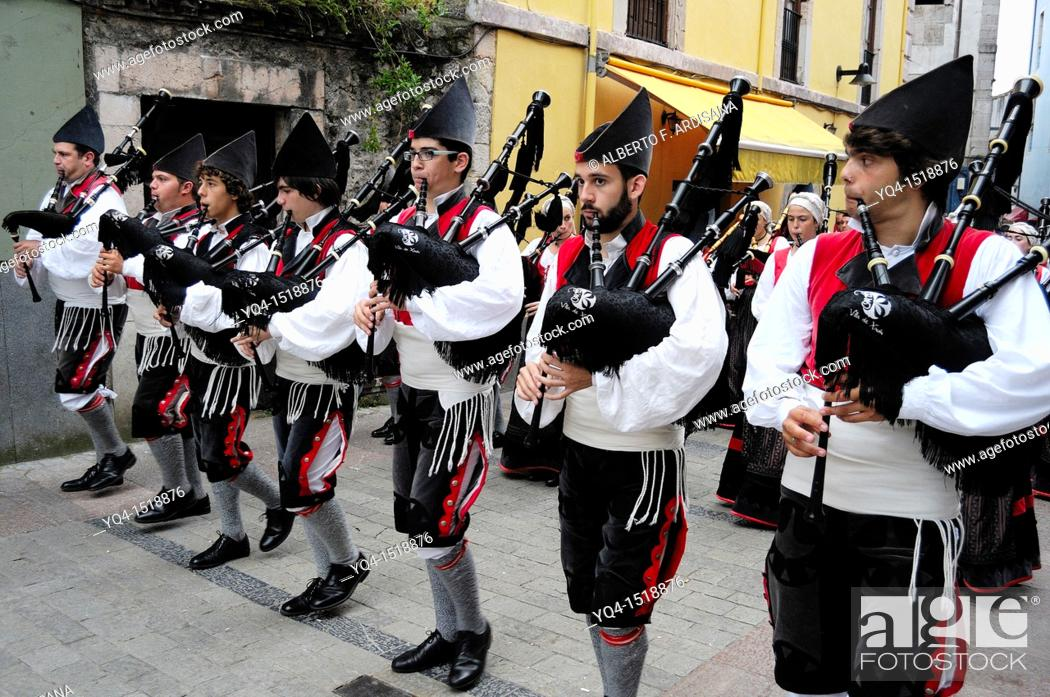 Stock Photo: Parade of pipe bands through the streets of Llanes during the festival of San Roque, Llanes, Asturias, Spain.
