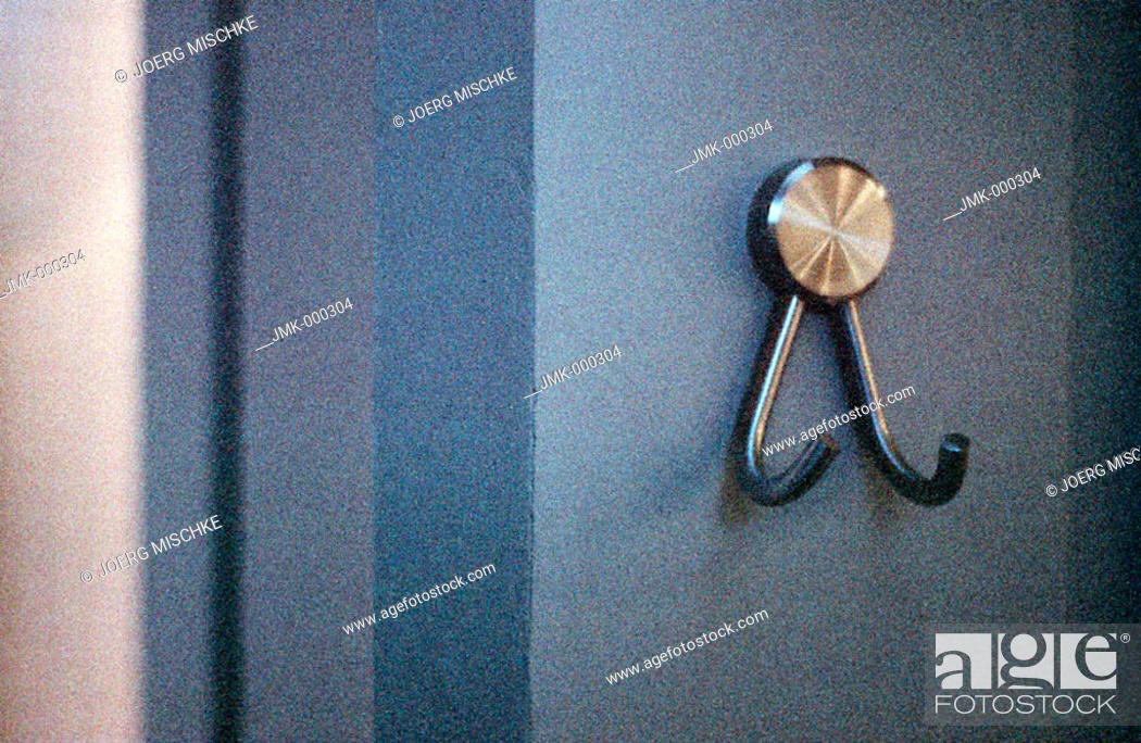 Stock Photo: Clothes-peg, coat-hook at a blue wall, door.