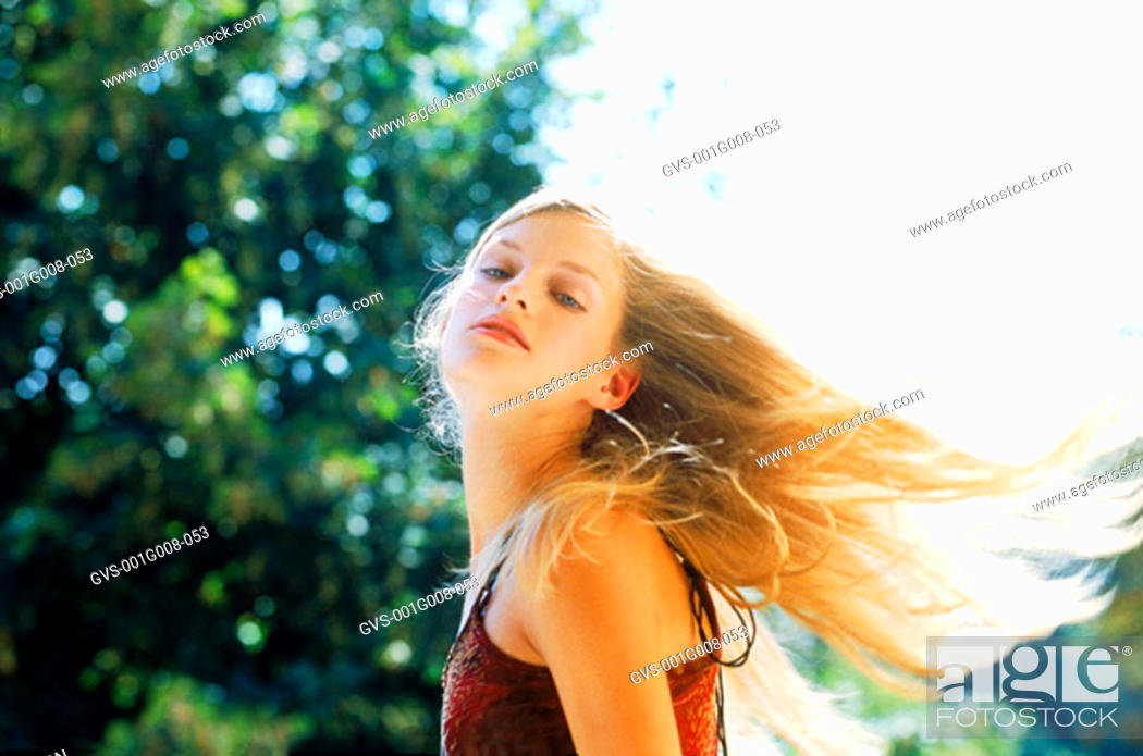 Stock Photo: Side profile of a young woman.