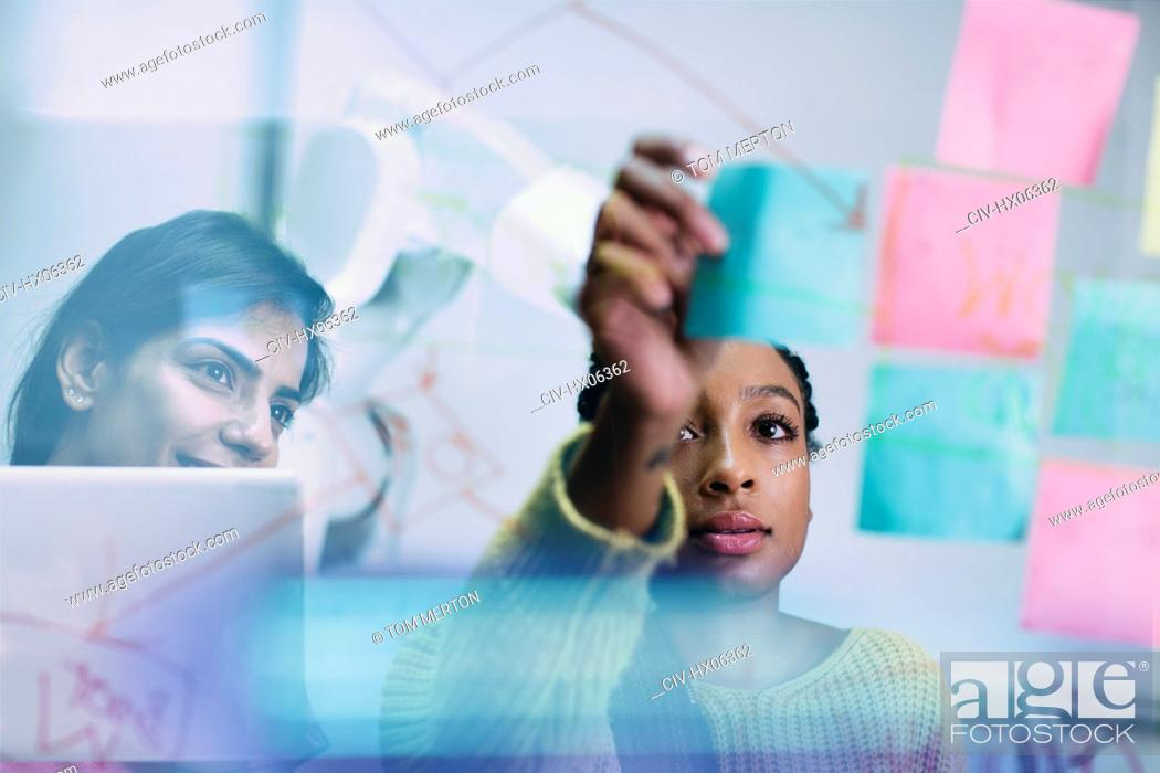 Stock Photo: Businesswomen with adhesive notes planning in office.