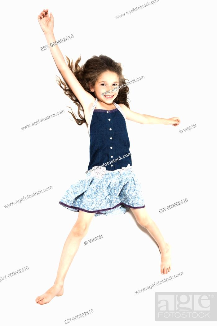 Stock Photo: caucasian little girl laying happy isolated studio on white background.