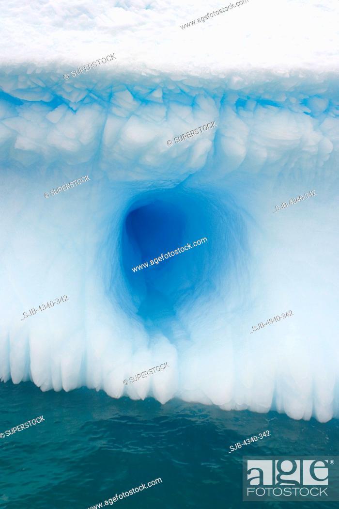 Stock Photo: Hole in an Iceberg.