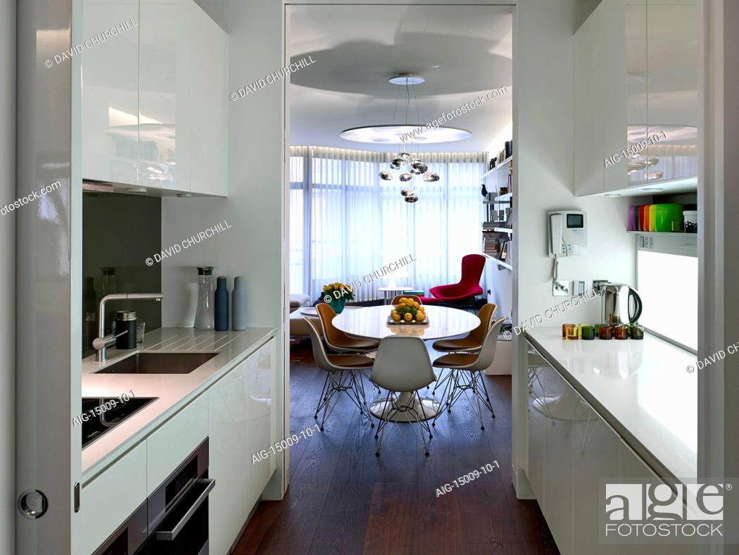 Stock Photo: Kitchen diner in Compass Court Apartment, Shad Thames, London, England, UK.