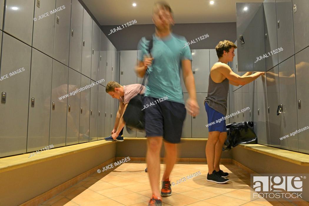 Stock Photo: Teenage boys getting ready in gym locker room.