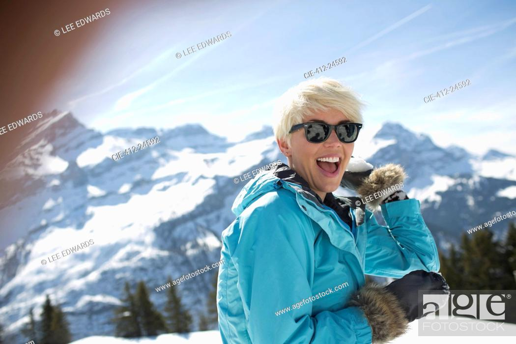 Stock Photo: Portrait of laughing woman in snow.