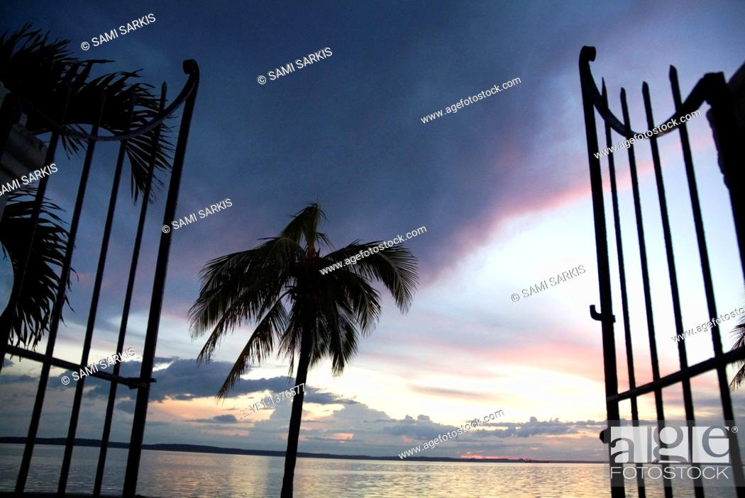 Stock Photo: Gate and Cienfuegos Bay at sunset from Punta Gorda, Cuba.