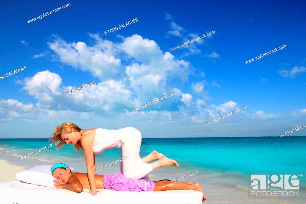 Stock Photo: Caribbean beach therapy shiatsu massage on knees women in paradise.