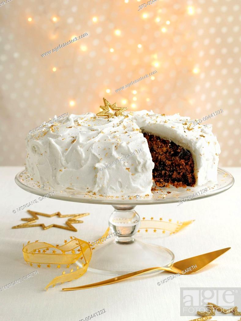 Stock Photo: Christmas cake, a piece removed (UK).