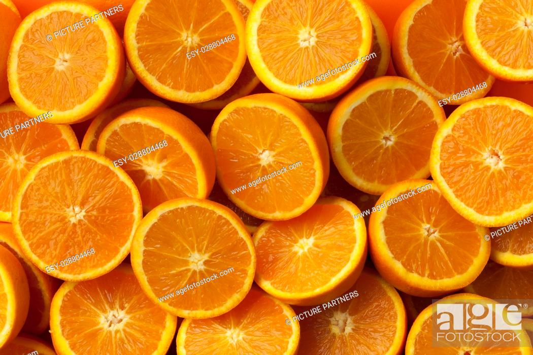 Stock Photo: Fresh cut half oranges full frame close up.