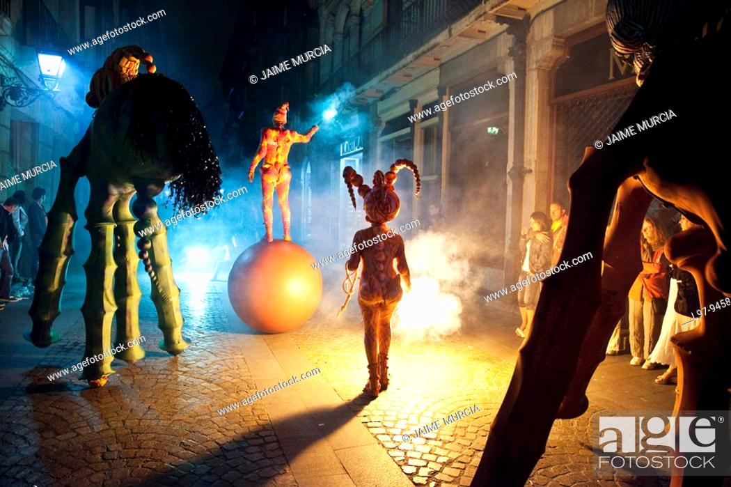 Stock Photo: Night time street performers Bilboa Spain.