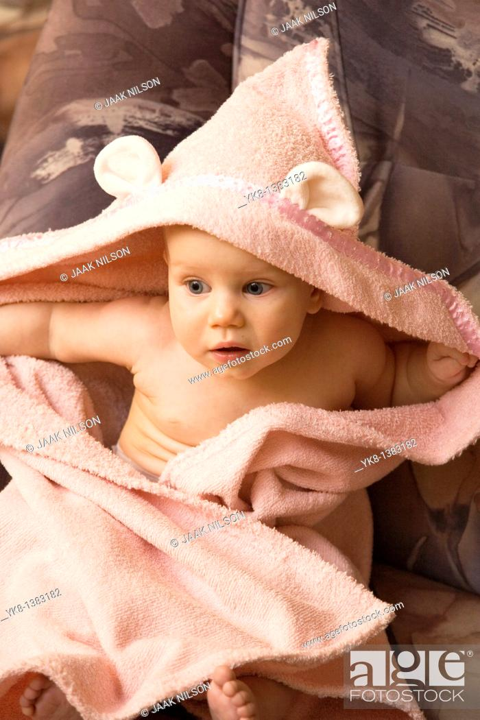 Stock Photo: Emotional Eight Month Old Infant Girl Sitting in Bathrobe.