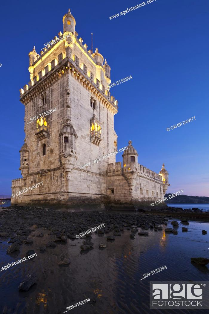 Stock Photo: The early 16th century Portuguese Manueline Style, Torre de Belem designed by the architect Francisco de Arruda at twilight with the River Tagus Estuary in the.