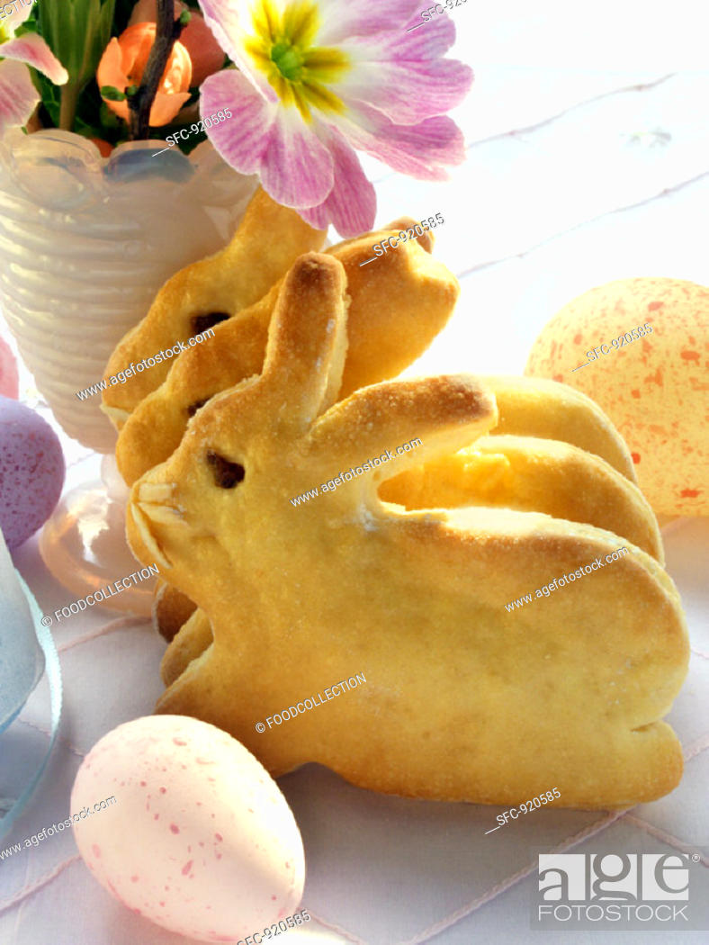Stock Photo: Easter Bunny in bread dough and coloured eggs.