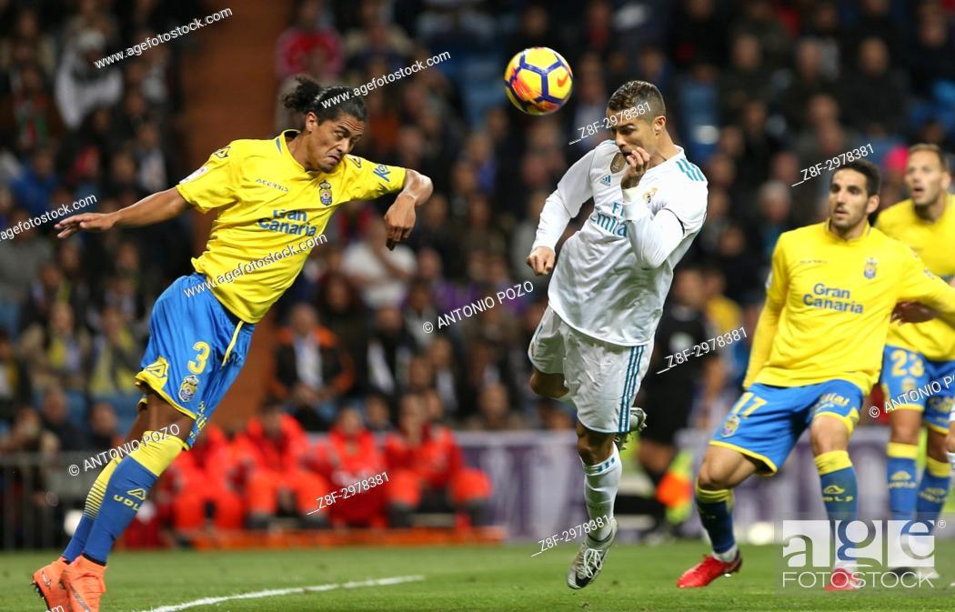 Stock Photo: MADRID, SPAIN. November 05, 2017 - Cristiano Ronaldo heads the ball in front of Mauricio Lemos. Real Madrid defeated Las Palmas 3-0 with an spectacular goal.