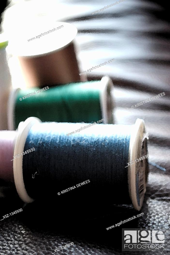 Stock Photo: Several rolls of different colored thread with effects.