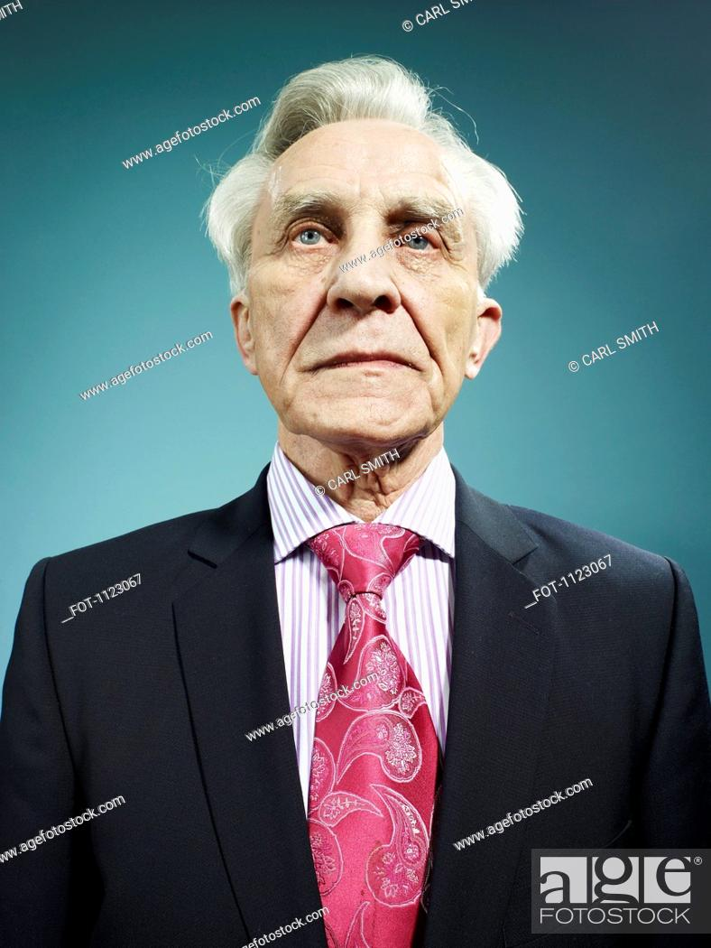 Stock Photo: An elegant senior man wearing a suit and bright pink tie.