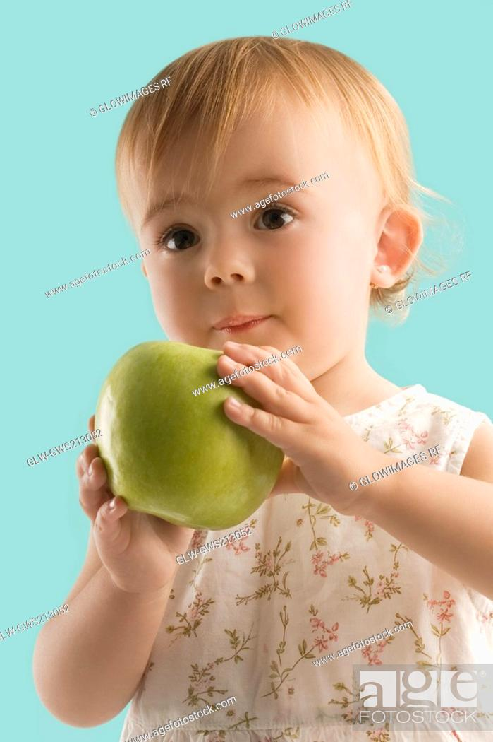 Stock Photo: Close-up of a girl holding an apple.