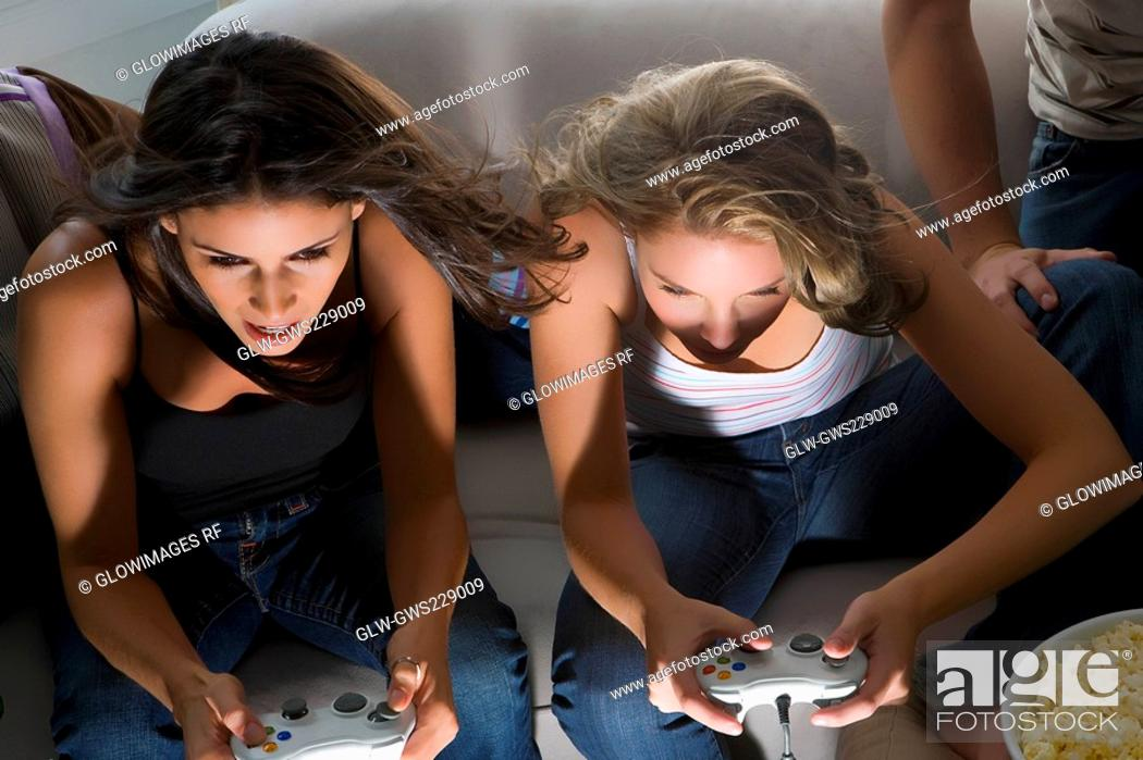 Stock Photo: High angle view of two young women playing video game.