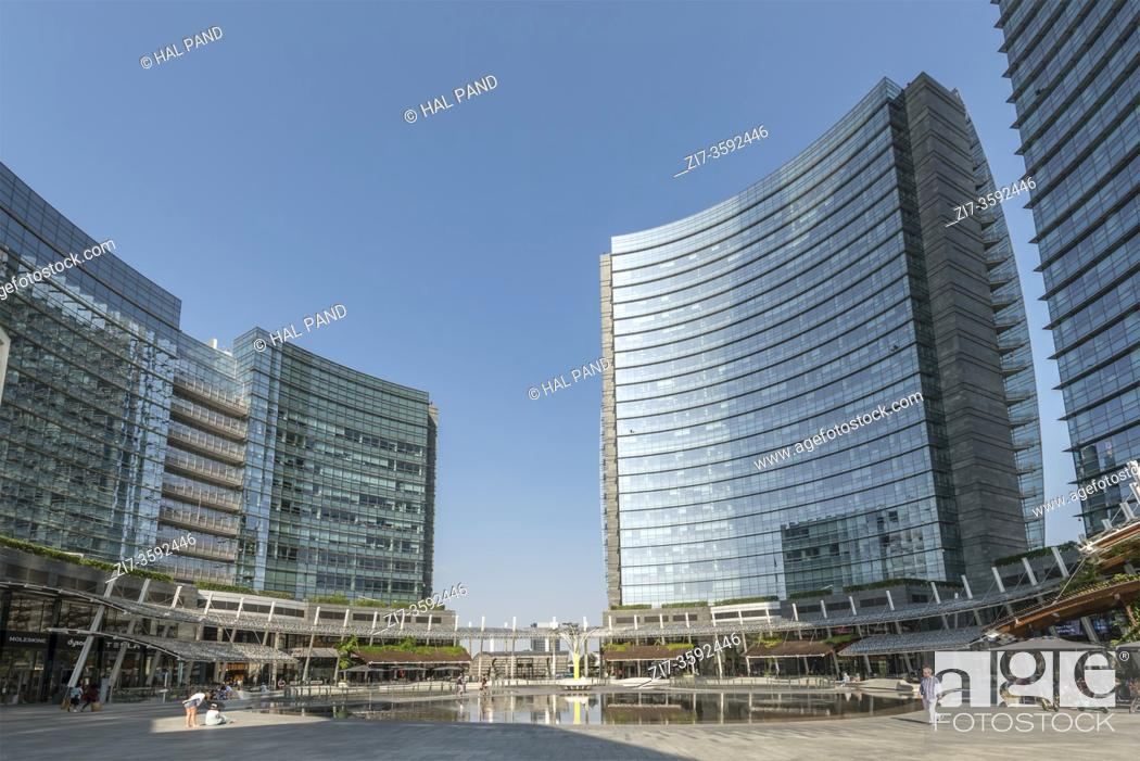 Stock Photo: MILAN, ITALY - August 20 2020: cityscape with almost no people around main pond at business hub urban renewal development, shot on august 20 2020 at Milan.