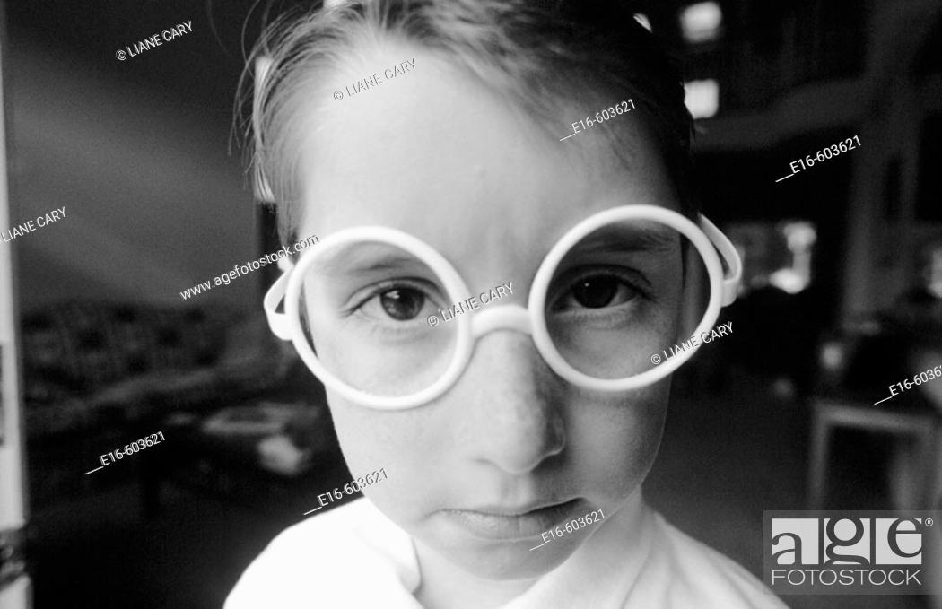 Stock Photo: Boy with pretend glasses.
