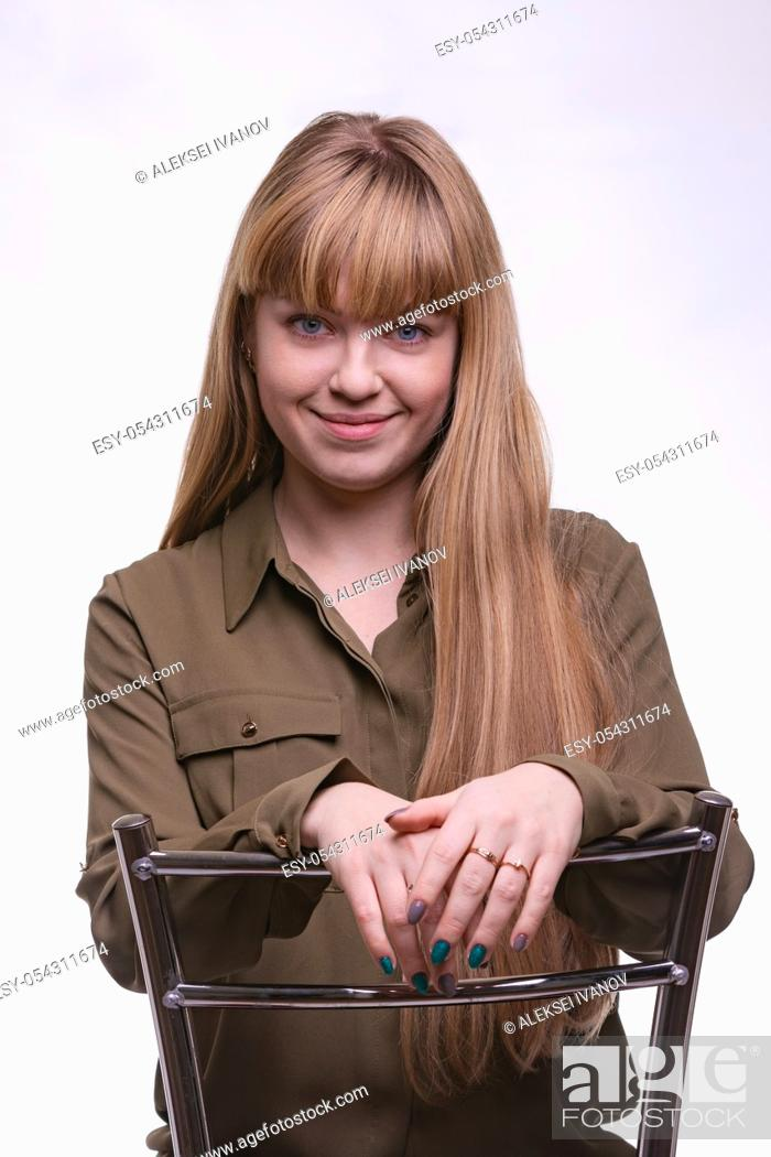 Stock Photo: portrait of blonde with hair and bangs on a white background.