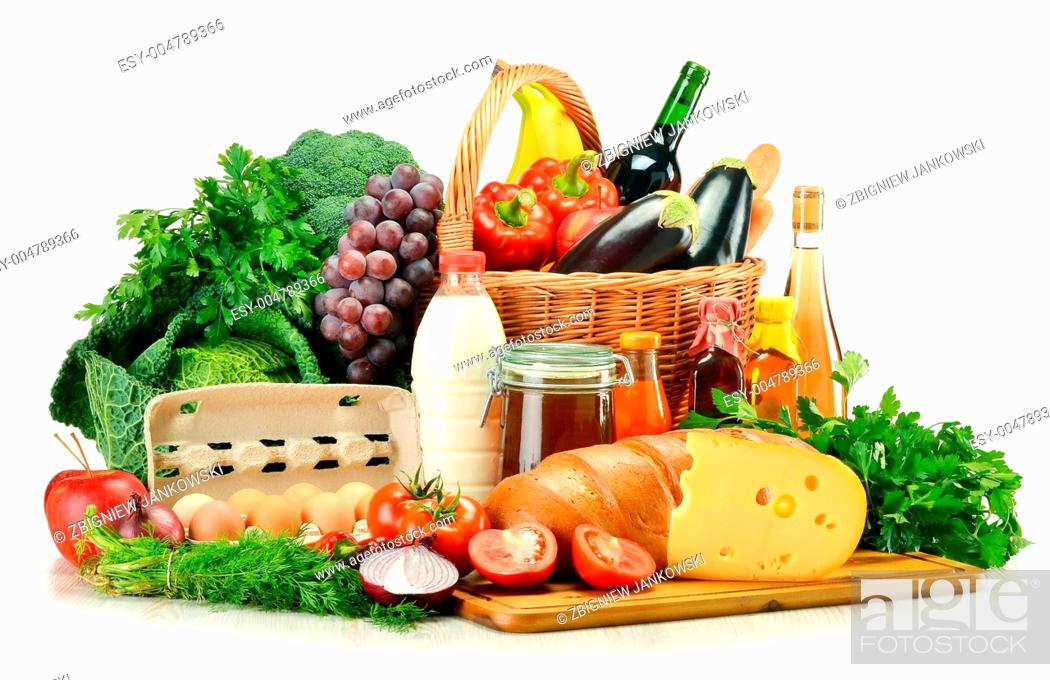 Stock Photo: Groceries in wicker basket including vegetables and fruits isolated on white.