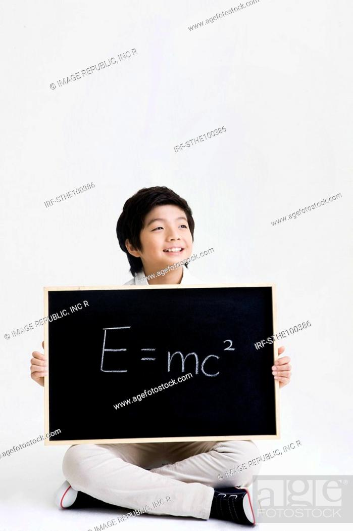 Stock Photo: boy holding a blackboard.