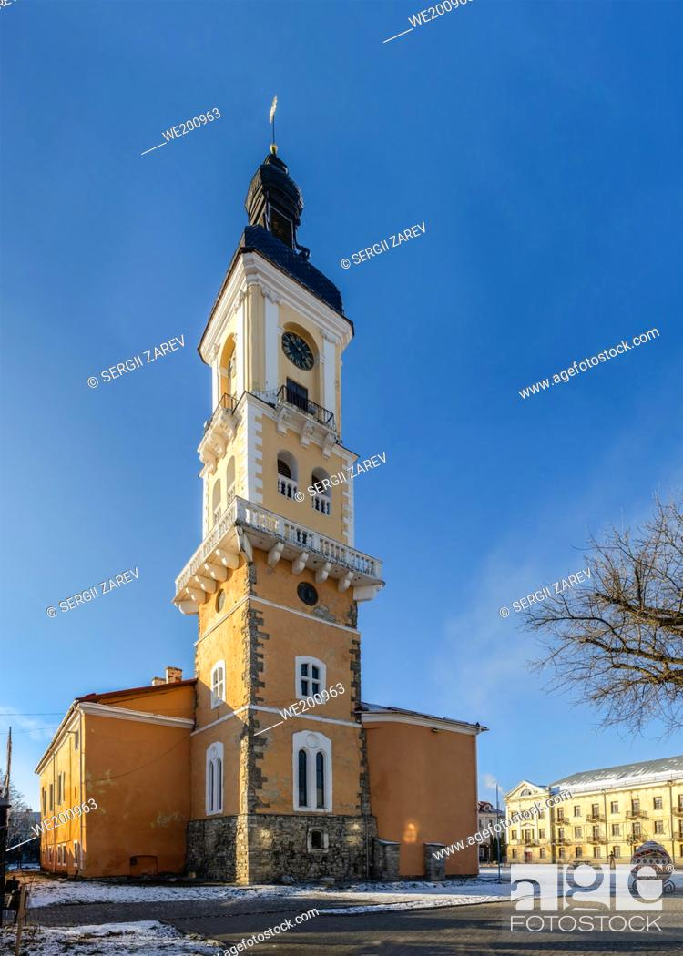 Stock Photo: Kamianets-Podilskyi, Ukraine 01. 07. 2020. The old Town hall of Kamianets-Podilskyi historical centre on a sunny winter morning.