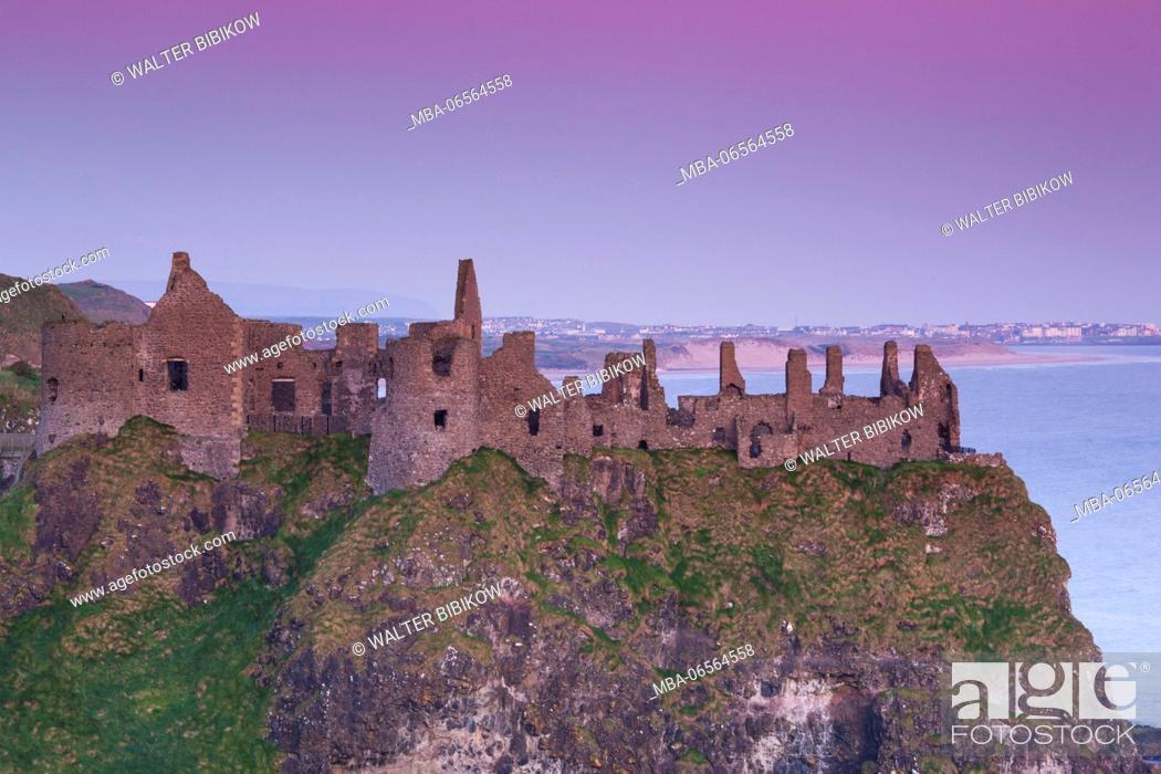 Stock Photo: UK, Northern Ireland, County Antrim, Bushmills, Dunluce Castle ruins, dawn.
