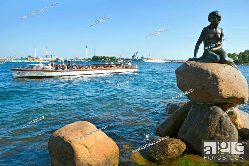 Stock Photo: The Little mermaid statue with tour boat, Copenhagen, Denmark.