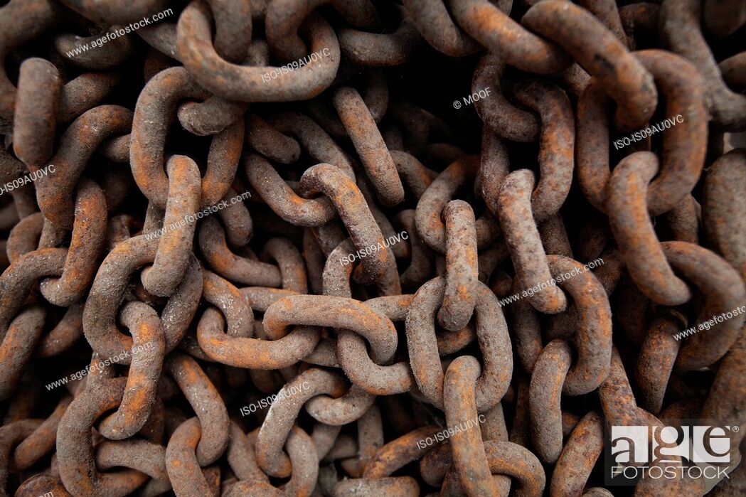 Stock Photo: Close up of rusted metal chains.