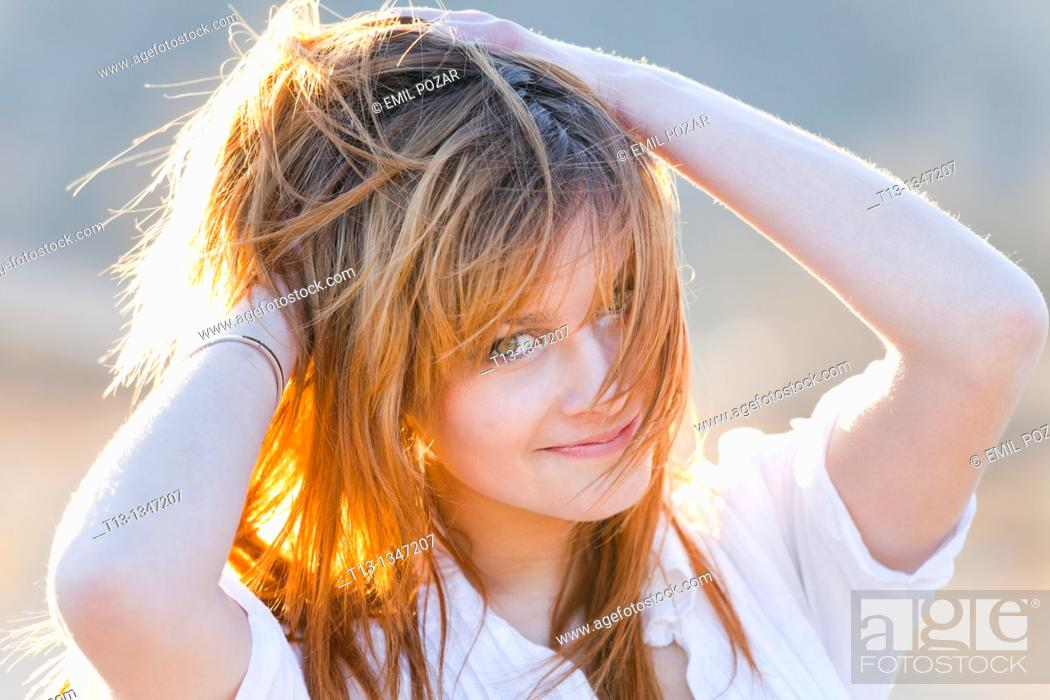 Stock Photo: Happy with a messy hair young woman portrait.