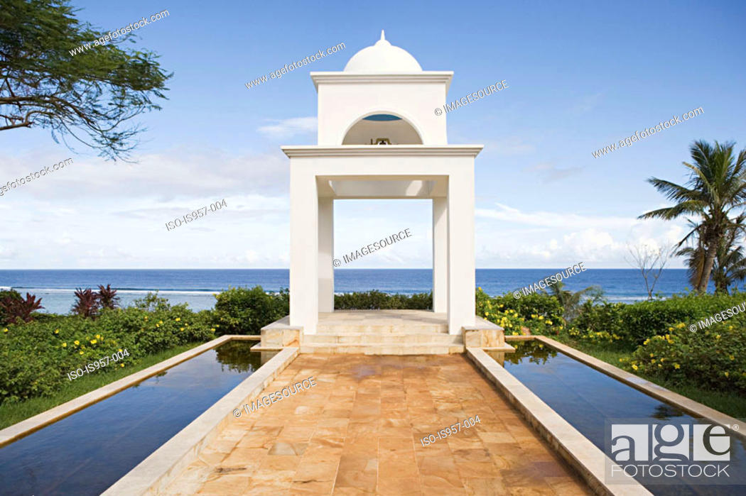 Stock Photo: White building by ocean.