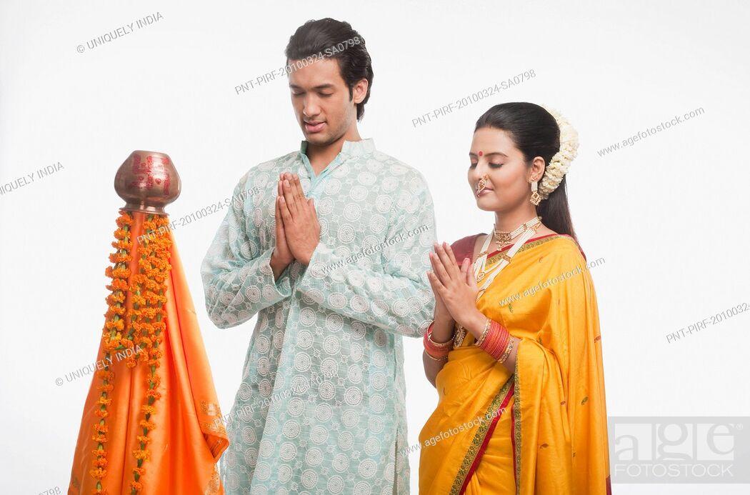 Stock Photo: Couple praying on Gudi Padwa festival.