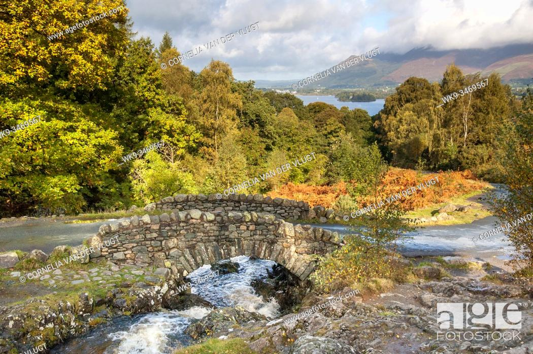 Stock Photo: Ashness Bridge during early autumn in the English Lake District. Derwent Water and the Skiddaw range are visible in the background.