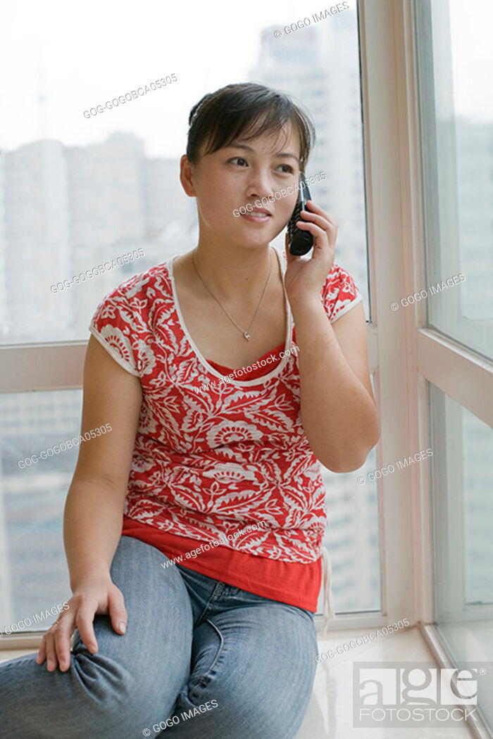 Stock Photo: Young woman talking on the telephone.