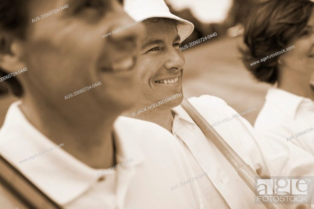 Stock Photo: Close-up of a mature man and a mid adult couple.