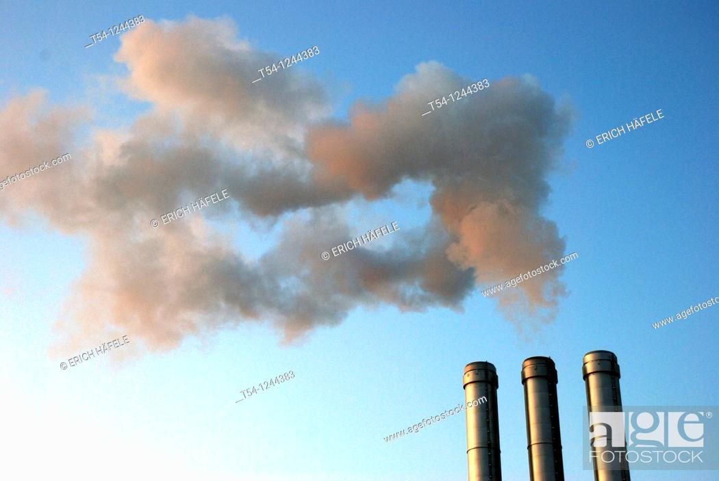 Stock Photo: Smoke clouds in the chimney of a heating plant in Wuerzburg.