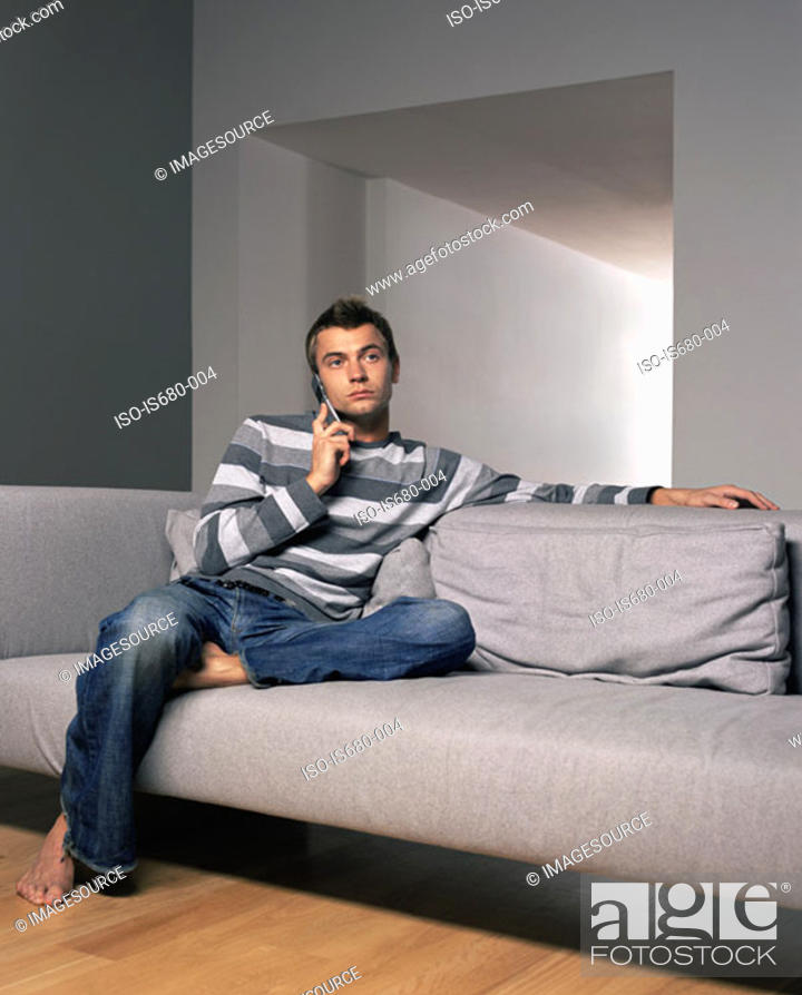 Stock Photo: Young man on mobile phone.